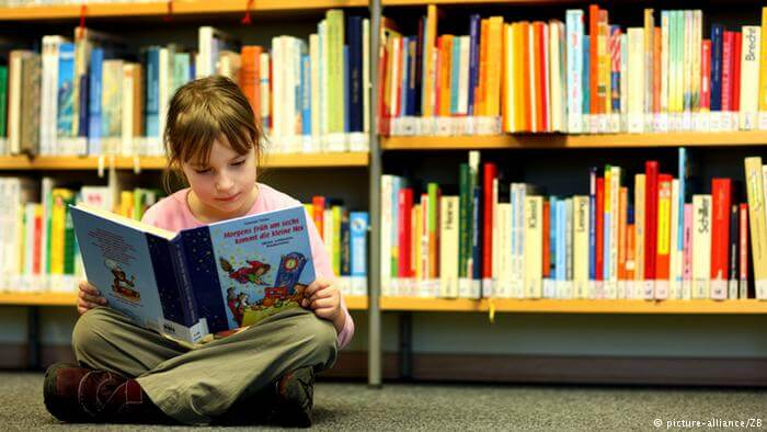 Child reading educational books